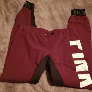 Burgundy, black, and white drawstring jogger pants